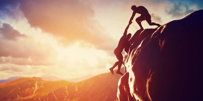 bigstock-Hikers-climbing-on-rock-mount-66403036